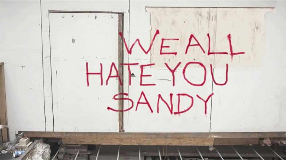 """We all hate you Sandy"" graffiti"