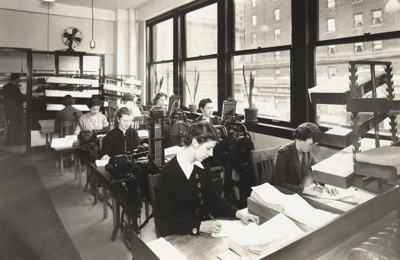 Old picture of workers in an administrative office