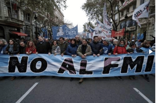 Union workers, along with members of social, political and students organisations, demonstrate against the government's negotiations with the International Monetary Fund in Buenos Aires